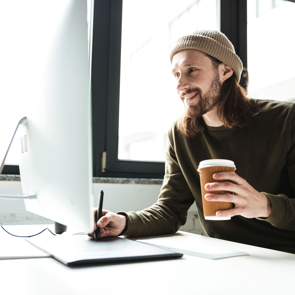 man in office using computer